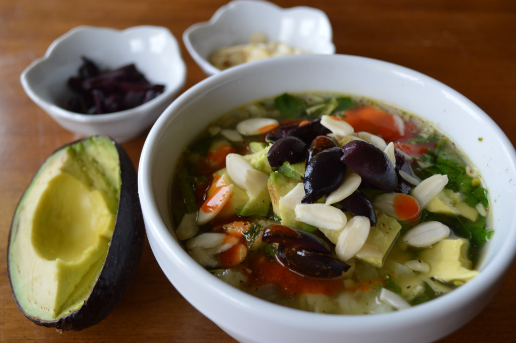 Vegetable Posole in Broth topped with Avocado, Almonds and Olives image